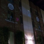 The Centennial logo and hashtag, as well as butterflies and birds, were projected onto the Atrium's brick wall.